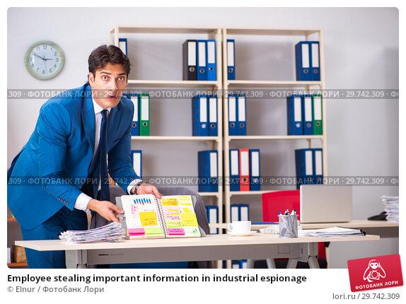 Купить «Employee stealing important information in industrial espionage», фото № 29742309, снято 10 августа 2018 г. (c) Elnur / Фотобанк Лори
