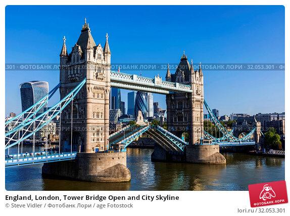 England, London, Tower Bridge Open and City Skyline. Стоковое фото, фотограф Steve Vidler / age Fotostock / Фотобанк Лори
