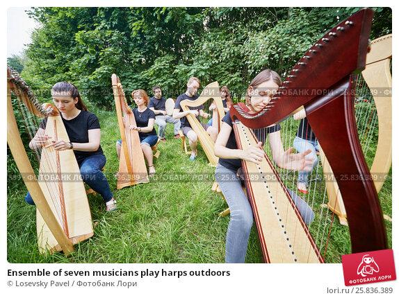 Купить «Ensemble of seven musicians play harps outdoors», фото № 25836389, снято 19 июня 2016 г. (c) Losevsky Pavel / Фотобанк Лори