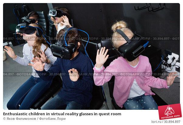 Купить «Enthusiastic children in virtual reality glasses in quest room», фото № 30894897, снято 21 октября 2017 г. (c) Яков Филимонов / Фотобанк Лори
