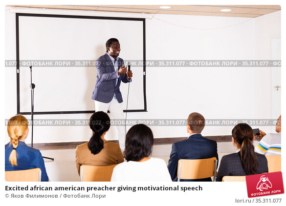 Excited african american preacher giving motivational speech. Стоковое фото, фотограф Яков Филимонов / Фотобанк Лори
