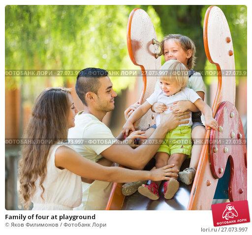 Купить «Family of four at playground», фото № 27073997, снято 11 декабря 2017 г. (c) Яков Филимонов / Фотобанк Лори