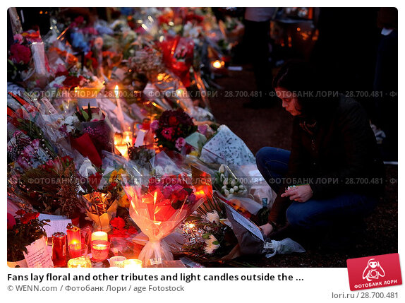 Купить «Fans lay floral and other tributes and light candles outside the home of singer George Michael in memory of the popular performer. His Range Rover has...», фото № 28700481, снято 28 декабря 2016 г. (c) age Fotostock / Фотобанк Лори