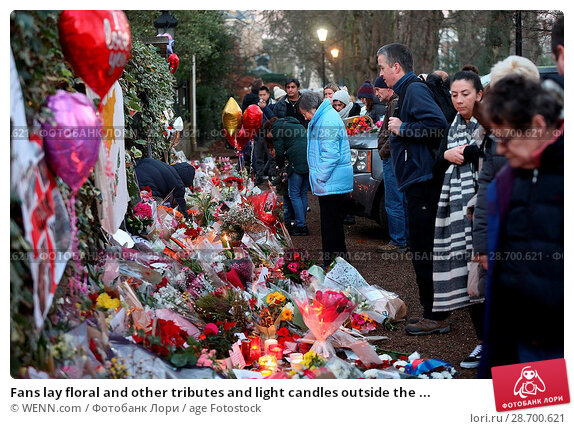 Купить «Fans lay floral and other tributes and light candles outside the home of singer George Michael in memory of the popular performer. His Range Rover has...», фото № 28700621, снято 28 декабря 2016 г. (c) age Fotostock / Фотобанк Лори