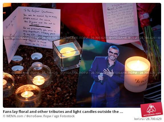 Купить «Fans lay floral and other tributes and light candles outside the home of singer George Michael in memory of the popular performer. His Range Rover has...», фото № 28700629, снято 28 декабря 2016 г. (c) age Fotostock / Фотобанк Лори