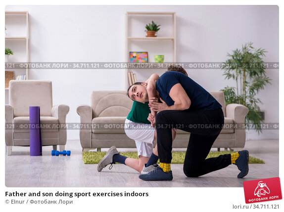Father and son doing sport exercises indoors. Стоковое фото, фотограф Elnur / Фотобанк Лори