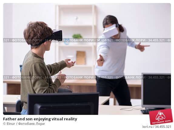 Father and son enjoying vitual reality. Стоковое фото, фотограф Elnur / Фотобанк Лори