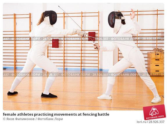 Купить «female athletes practicing movements at fencing battle», фото № 28926337, снято 11 июля 2018 г. (c) Яков Филимонов / Фотобанк Лори
