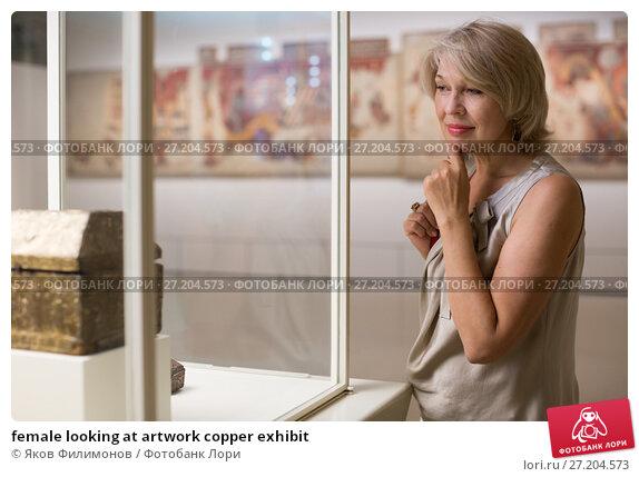 Купить «female looking at artwork copper exhibit», фото № 27204573, снято 7 октября 2017 г. (c) Яков Филимонов / Фотобанк Лори