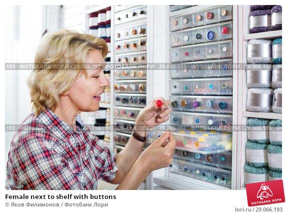 Купить «Female next to shelf with buttons», фото № 29066193, снято 20 мая 2019 г. (c) Яков Филимонов / Фотобанк Лори