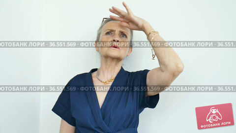 Female portrait of beautiful old grandmother with grey hair and face with wrinkles is grimacing while looking at the camera on white background, mothers day, happy retirement. Стоковое видео, видеограф Ольга Балынская / Фотобанк Лори