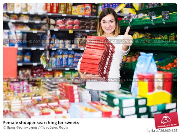Купить «Female shopper searching for sweets», фото № 26969625, снято 23 ноября 2016 г. (c) Яков Филимонов / Фотобанк Лори