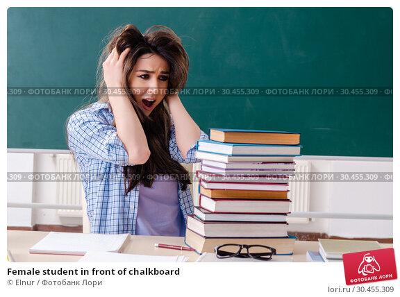 Female student in front of chalkboard. Стоковое фото, фотограф Elnur / Фотобанк Лори