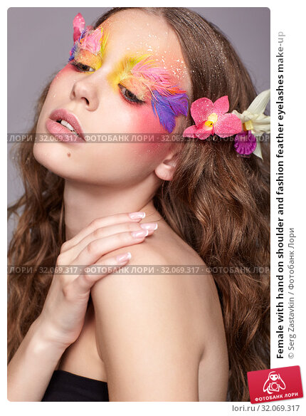 Female with hand on shoulder and fashion feather eyelashes make-up. Стоковое фото, фотограф Serg Zastavkin / Фотобанк Лори