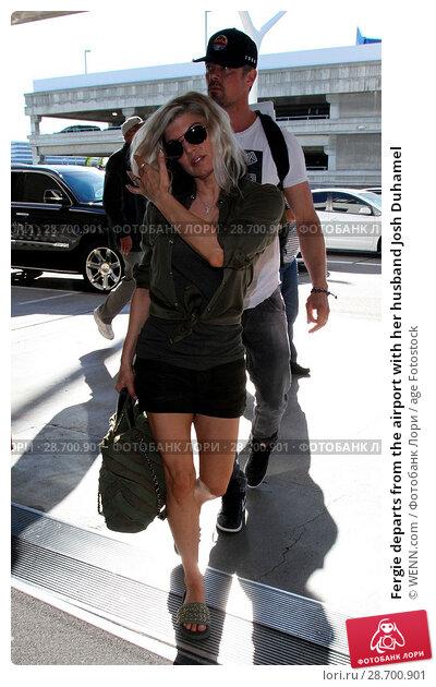 Купить «Fergie departs from the airport with her husband Josh Duhamel Featuring: Fergie, Josh Duhamel Where: Los Angeles, California, United States When: 29 Dec 2016 Credit: WENN.com», фото № 28700901, снято 29 декабря 2016 г. (c) age Fotostock / Фотобанк Лори