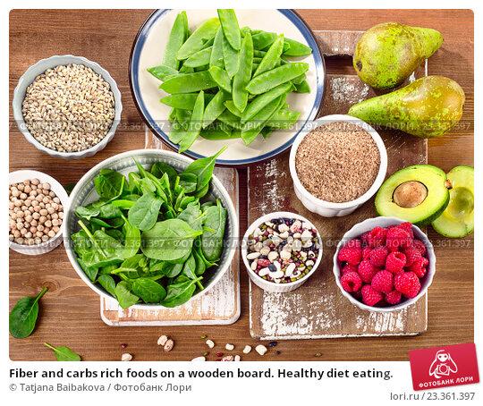Купить «Fiber and carbs rich foods on a wooden board. Healthy diet eating.», фото № 23361397, снято 14 марта 2016 г. (c) Tatjana Baibakova / Фотобанк Лори
