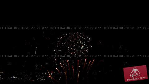Купить «Fireworks flashing in the evening», видеоролик № 27386877, снято 10 декабря 2017 г. (c) Игорь Жоров / Фотобанк Лори