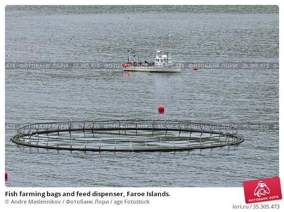 Fish farming bags and feed dispenser, Faroe Islands. Стоковое фото, фотограф Andre Maslennikov / age Fotostock / Фотобанк Лори