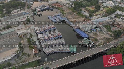Купить «Fishing Boats parking on the river in Asia 4k Drone shot», видеоролик № 32391857, снято 4 ноября 2019 г. (c) Aleksejs Bergmanis / Фотобанк Лори