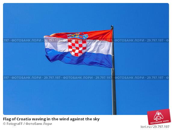 Flag of Croatia waving in the wind against the sky. Стоковое фото, фотограф FotograFF / Фотобанк Лори