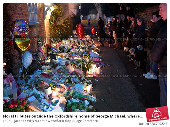 Купить «Floral tributes outside the Oxfordshire home of George Michael, where he was found dead on Christmas Day at Goring-on-Thames Featuring: Atmosphere Where...», фото № 28700545, снято 28 декабря 2016 г. (c) age Fotostock / Фотобанк Лори