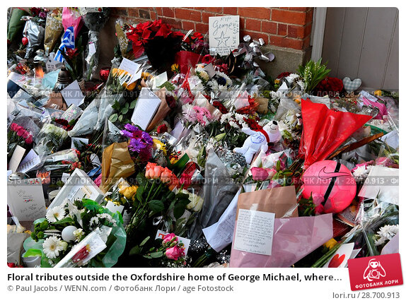 Купить «Floral tributes outside the Oxfordshire home of George Michael, where he was found dead on Christmas Day at Goring-on-Thames Featuring: Atmosphere Where...», фото № 28700913, снято 28 декабря 2016 г. (c) age Fotostock / Фотобанк Лори