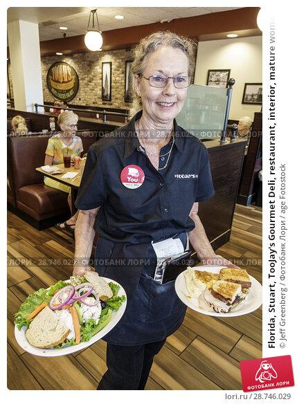 Купить «Florida, Stuart, TooJay's Gourmet Deli, restaurant, interior, mature woman, waitress server serving, carrying food plates, sandwich,», фото № 28746029, снято 27 сентября 2017 г. (c) age Fotostock / Фотобанк Лори