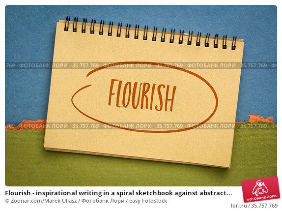 Flourish - inspirational writing in a spiral sketchbook against abstract... Стоковое фото, фотограф Zoonar.com/Marek Uliasz / easy Fotostock / Фотобанк Лори