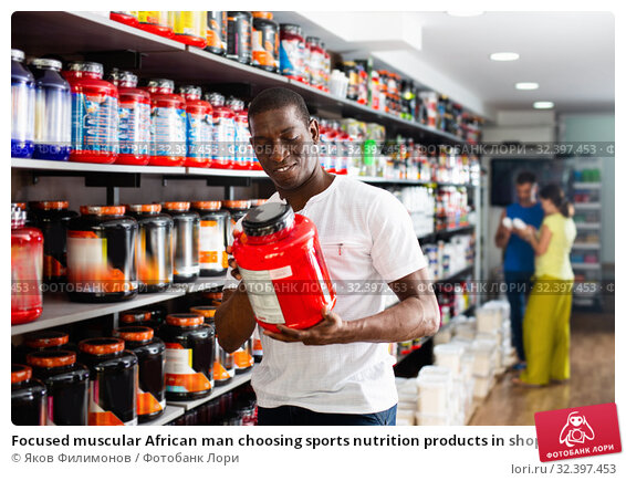 Купить «Focused muscular African man choosing sports nutrition products in shop, reading content label», фото № 32397453, снято 20 января 2020 г. (c) Яков Филимонов / Фотобанк Лори