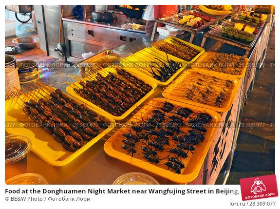 Купить «Food at the Donghuamen Night Market near Wangfujing Street in Beijing, China», фото № 28309077, снято 25 августа 2019 г. (c) BE&W Photo / Фотобанк Лори