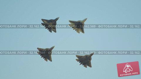 Купить «Four green military fighter jets flying in the sky», видеоролик № 32162569, снято 18 сентября 2019 г. (c) Константин Шишкин / Фотобанк Лори
