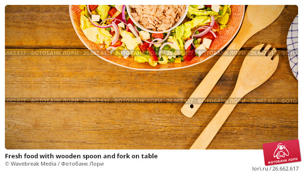 Fresh food with wooden spoon and fork on table, фото № 26662617, снято 27 июля 2017 г. (c) Wavebreak Media / Фотобанк Лори