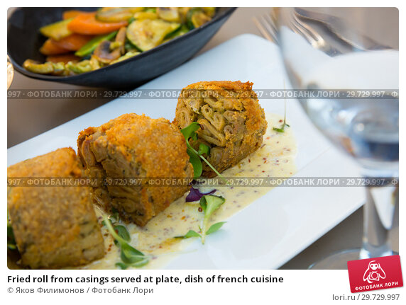 Купить «Fried roll from casings served at plate, dish of french cuisine», фото № 29729997, снято 12 октября 2018 г. (c) Яков Филимонов / Фотобанк Лори