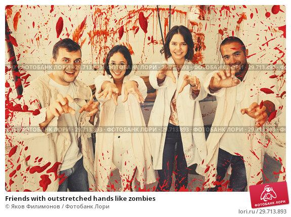 Купить «Friends with outstretched hands like zombies», фото № 29713893, снято 8 октября 2018 г. (c) Яков Филимонов / Фотобанк Лори