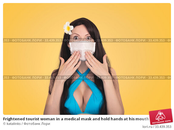 Купить «Frightened tourist woman in a medical mask and hold hands at his mouth in fear», фото № 33439353, снято 18 марта 2020 г. (c) katalinks / Фотобанк Лори