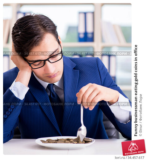 Funny businessman eating gold coins in office. Стоковое фото, фотограф Elnur / Фотобанк Лори