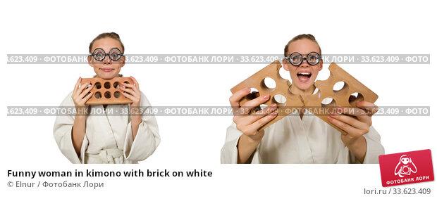 Купить «Funny woman in kimono with brick on white», фото № 33623409, снято 18 июля 2015 г. (c) Elnur / Фотобанк Лори