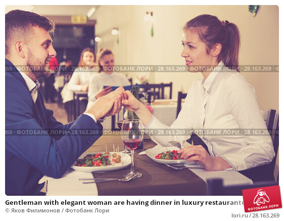 Купить «Gentleman with elegant woman are having dinner in luxury restaurante», фото № 28163269, снято 18 декабря 2017 г. (c) Яков Филимонов / Фотобанк Лори