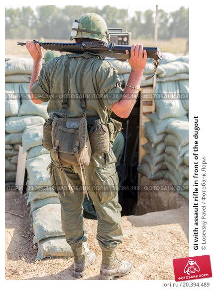 Купить «GI with assault rifle in front of the dugout», фото № 20394489, снято 12 июля 2014 г. (c) Losevsky Pavel / Фотобанк Лори