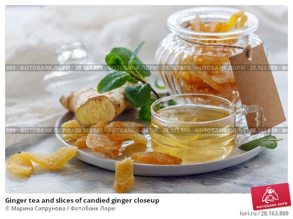 Купить «Ginger tea and slices of candied ginger closeup», фото № 28163889, снято 9 марта 2018 г. (c) Марина Сапрунова / Фотобанк Лори