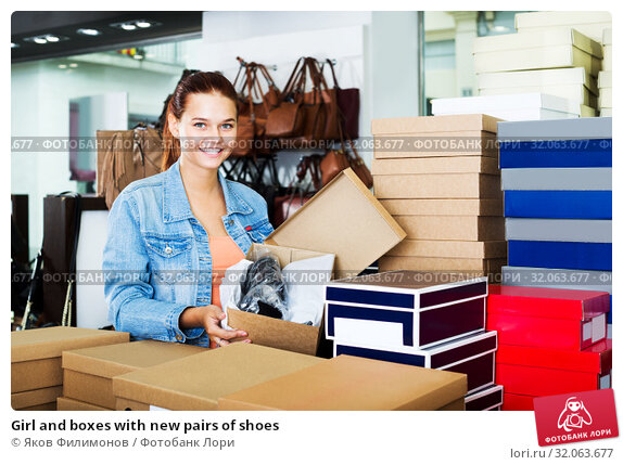 Girl and boxes with new pairs of shoes. Стоковое фото, фотограф Яков Филимонов / Фотобанк Лори
