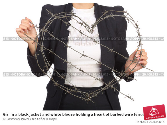 Купить «Girl in a black jacket and white blouse holding a heart of barbed wire fence», фото № 20408613, снято 7 июня 2014 г. (c) Losevsky Pavel / Фотобанк Лори