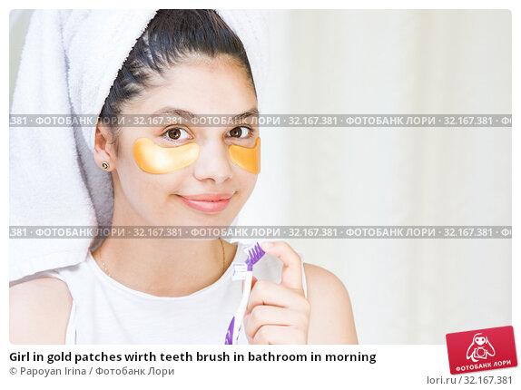 Купить «Girl in gold patches wirth teeth brush in bathroom in morning», фото № 32167381, снято 6 июля 2019 г. (c) Papoyan Irina / Фотобанк Лори