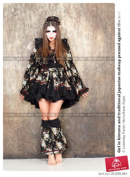 Купить «Girl in kimono and traditional Japanise makeup pressed against the wall studio shot», фото № 25839481, снято 17 ноября 2014 г. (c) Losevsky Pavel / Фотобанк Лори
