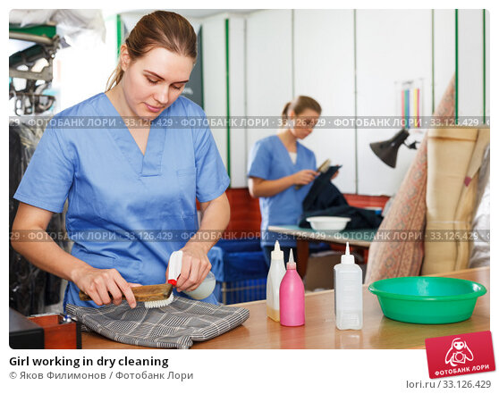 Купить «Girl working in dry cleaning», фото № 33126429, снято 9 мая 2018 г. (c) Яков Филимонов / Фотобанк Лори