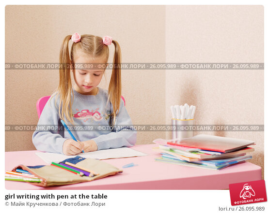 Купить «girl writing with pen at the table», фото № 26095989, снято 4 октября 2016 г. (c) Майя Крученкова / Фотобанк Лори