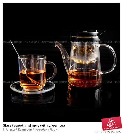 Glass teapot and mug with green tea. Стоковое фото, фотограф Алексей Кузнецов / Фотобанк Лори