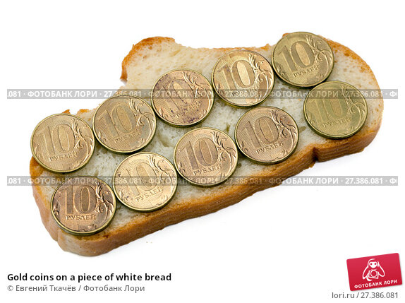 Купить «Gold coins on a piece of white bread», фото № 27386081, снято 31 января 2016 г. (c) Евгений Ткачёв / Фотобанк Лори