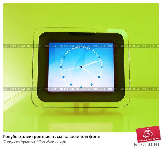Голубые электронные часы на зеленом фоне, фото № 185661, снято 19 сентября 2006 г. (c) Андрей Армягов / Фотобанк Лори