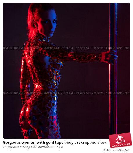 Gorgeous woman with gold tape body art cropped view. Стоковое фото, фотограф Гурьянов Андрей / Фотобанк Лори